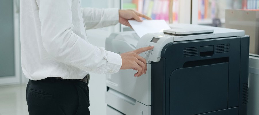 Person scanning a document on a copier